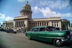 Cuba- Capitolio Nacional & Car. Capitolio Nacional and green American car, Havana Royalty Free Stock Photo