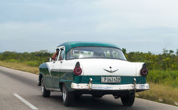 Cuba caribbean american classic car driver on the street Stock Photography