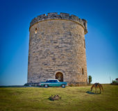 Cuba castle. A small castle tower in varadero,cuba,with an old american car and a horse