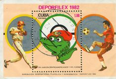 Footballer and crocodile. CUBA - CIRCA 1982: stamp printed by Cuba, shows Ballplayer, footballer and crocodile, circa 1982 Royalty Free Stock Photography