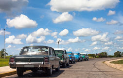 Cuba classic cars lined up drived on the road. Cuba blue classic car drived on the road Stock Photo