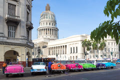 Cuba classic cars parked in series in Havana with Capitol view Stock Photography
