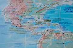 Cuba in close up on the map. Focus on the name of country. Vignetting effect.  stock photography
