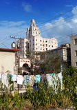 Cuba. Contrasts of old Havana - high-rise buildings and linen drying in the forefront in yard Stock Images