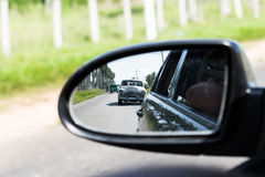 Cuba countryside view rearview mirror with a vintage Stock Photography