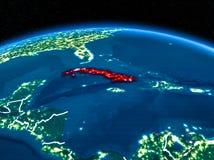 Cuba do espaço na noite Fotografia de Stock Royalty Free