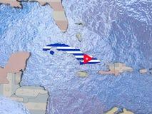Cuba with flag on globe Stock Photography