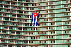 Cuba flag hanging on Riviera Hotel. Picture of a flag of Cuba hanging from two windows of Riviera Hotel`s building in La Habana Cuba Stock Images
