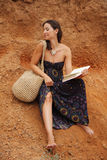 Cuba girl. Fashion woman on red sand with book royalty free stock photography