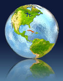 Cuba on globe with reflection. Illustration with detailed planet surface. Elements of this image furnished by NASA Royalty Free Stock Image