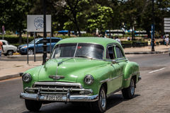 Cuba green american Oldtimer on the promenade street in Havana Royalty Free Stock Photography