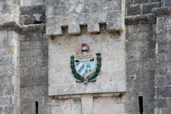 Cuba, Habana, center of the old town, the old coat of arms of Havana. Cuba, Habana, the center of the old town.Central old historical part of Habana, old houses Royalty Free Stock Photos
