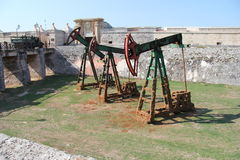 Cuba, Habana, the fortress, the moat, old oil rigs. stock photos