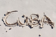Cuba handwritten on the white sand Stock Photography