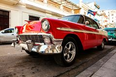 Cuba, Havana: American classic car with cuba flag parked on the royalty free stock photo
