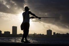 Cuba, Havana, Angler during sunset Royalty Free Stock Photos