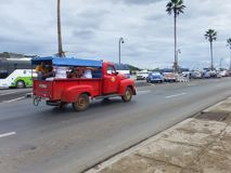 Fixed route taxi. Cuba, Havana, Malecon Embankment, December 05, 2015, an old Ford truck used in place of a public transport, transports residents of the city Royalty Free Stock Image