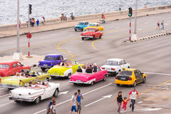 CUBA, HAVANA - May 5, 2017: American beige retro-car rides along the seafront Malokon. Copy space for text. Royalty Free Stock Images