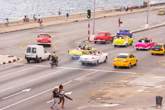 CUBA, HAVANA - May 5, 2017: American beige retro-car rides along the seafront Malokon. Copy space for text. Stock Photography