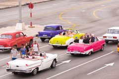 CUBA, HAVANA - May 5, 2017: American beige retro-car rides along the seafront Malokon. Copy space for text. Royalty Free Stock Image