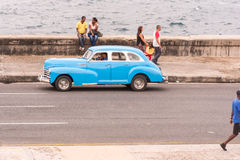 CUBA, HAVANA - MAY 5, 2017: American blue retro car on city street. Copy space for text. Royalty Free Stock Photos