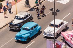 CUBA, HAVANA - MAY 5, 2017: American multicolored retro cars in the parking lot. �opy space for text. Top view. Stock Images