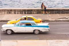 CUBA, HAVANA - MAY 5, 2017: American retro car rides along the Malecon waterfront. Copy space for text. CUBA, HAVANA - MAY 5, 2017: American retro car rides Stock Photography