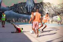 CUBA, HAVANA - MAY 5, 2017: Boys are playing football. Copy space for text. Stock Photos