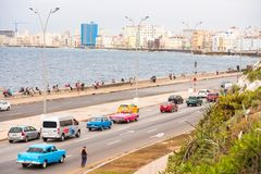 CUBA, HAVANA - MAY 5, 2017: Cars drive along the Malecon waterfront. Copy space for text. Stock Images