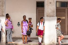 CUBA, HAVANA - MAY 5, 2017: Group of people near the building. �opy space for text. CUBA, HAVANA - MAY 5, 2017: Group of people near the building. Copy space Royalty Free Stock Images