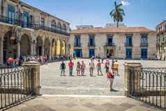 Tourists at the Cathedral Square on a beautiful day. Old Havana, Cuba. stock photos