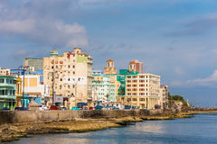 CUBA, HAVANA - MAY 5, 2017: View of residential buildings on the Malecon embankment. Copy space for text. CUBA, HAVANA - MAY 5, 2017: View of residential Royalty Free Stock Photo