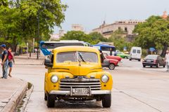 CUBA, HAVANA - MAY 5, 2017: Yellow American retro car on a city street. Copy space for text. stock photos