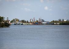 Cuba. Industrial factory buildings by the sea.  stock photography