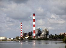 Cuba. Industrial factory buildings by the sea.  stock image