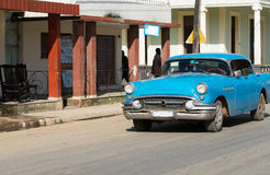Cuba inland american blue vintage car drives on the road Royalty Free Stock Images