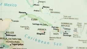 Cuba and Jamaica on a map with defocus. Cuba and Jamaica on a political map of the world. Video defocuses showing and hiding the map vector illustration