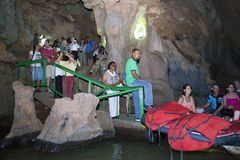 CUBA- JANUARY 28, 2013: people in queue on the boat on the underground river in Indian Cave in Vinales stock photography
