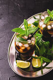 Cuba Libre cocktail with cola, lime, rum and peppermint Stock Photo