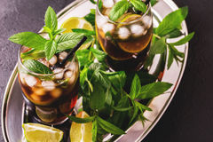 Cuba Libre cocktail with cola, lime, rum and peppermint stock image