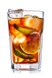 Cuba libre cocktail. Cube libre. Cocktail with soda with rum and lime slices in faceted highball glass Royalty Free Stock Photo