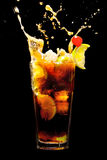 Splashing Cuba Libre Cocktail Royalty Free Stock Images