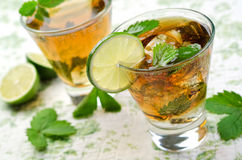 Cuba Libre. A delicious, refreshing Cuba Libre with lime and mint Royalty Free Stock Photography