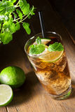 Cuba Libre Drink with lime Royalty Free Stock Photography