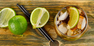 Cuba Libre Drink  on a wooden table Royalty Free Stock Image