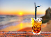 Cuba libre exotic tasty cocktail with beautiful sunset background Royalty Free Stock Images