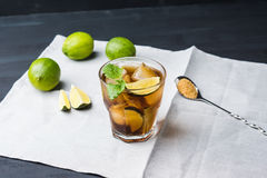 Cuba libre with lime Stock Image