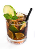Cuba Libre Longdrink (isolated on white). Cuba Libre Longdrink with brown rum and lime (isolated on white background royalty free stock image