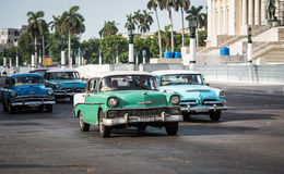 Cuba many american classic cars drives on the Main street with Capitol view in Havana Stock Photo