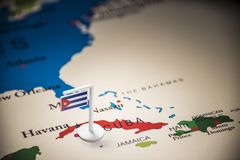 Cuba marked with a flag on the map.  royalty free stock image
